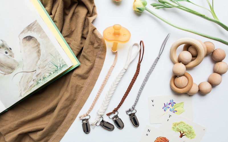 Check out these unique, visually-pleasing pacifier clips and baby accessories at Madeline's Box + a giveaway!
